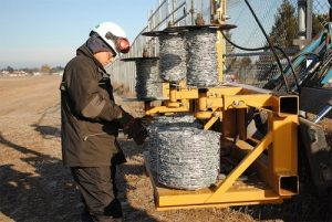New rolls of barbed wire are transported on the Barbed Wire Dispenser until they are needed.