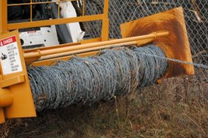 The rapid roller collects used barbed wire in a spool