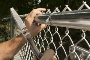 Secure the Self-Locking Fabric Band with the flat side of the fence tie.