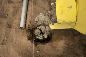 The Auger Bucket doesn't make a mess when it goes into the hole. It's very precise.