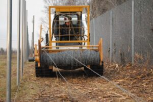 barb wire roller for skid steer